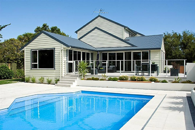 House that Joe lancaster & son LTD built with outdoor area and a pool.